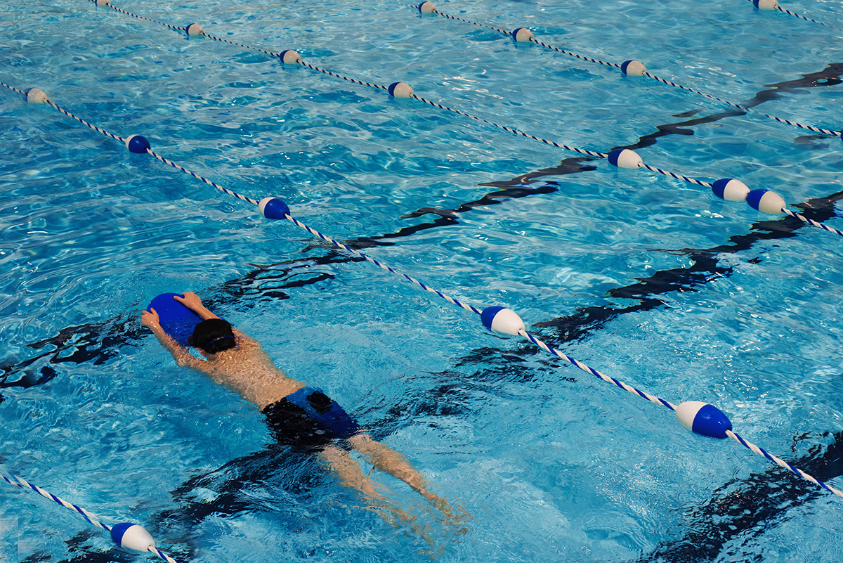 Swim Into Summer To Reduce Back Pain